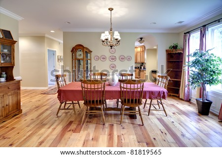 traditional diningroom with oak furniture and oak floors - stock photo