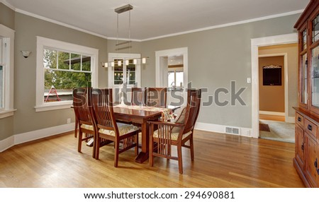 Traditional dinning room with hanging light fixture and windows. - stock photo
