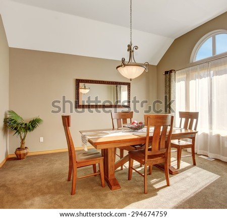 Traditional dinning room with tan carpet, in beautiful northwest home. - stock photo