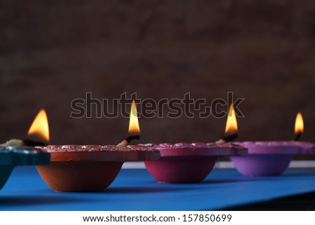 Traditional Diwali lamps  lit on the occasion of Diwali festival - stock photo
