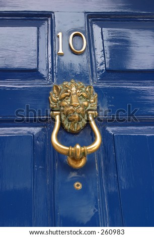 Traditional Door Knocker in the shape of a lions head - stock photo
