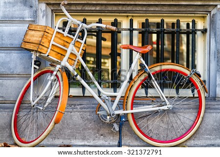 Traditional dutch bicycle parked at the front in Amsterdam, The Netherlands - stock photo