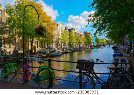 Traditional dutch bicycle parked on canal in Amsterdam - stock photo