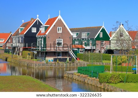 Traditional Dutch buildings with painted wood facades in Marken village, Holland  - stock photo