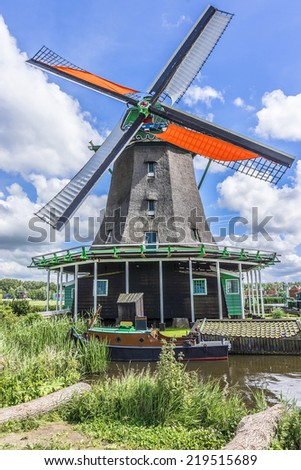 Traditional Dutch old wooden windmill in Zaanse Schans - museum village in Zaandam. The Netherlands.