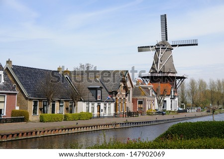 Traditional Dutch Village with wind mill - stock photo