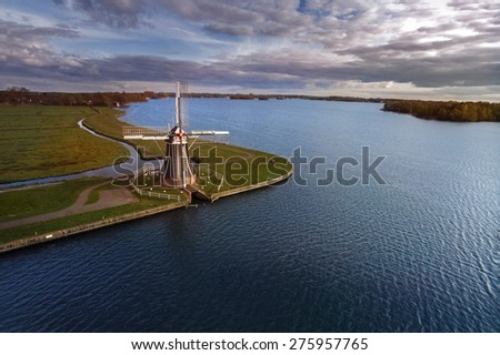 Traditional Dutch windmill at a lake. Aial view - stock photo