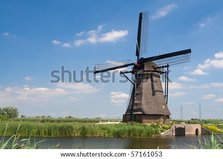 Traditional dutch windmill in famous Kinderdijk, The Netherlands - stock photo