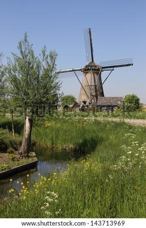 Traditional Dutch windmill near Kinderdijk, The Netherlands - stock photo