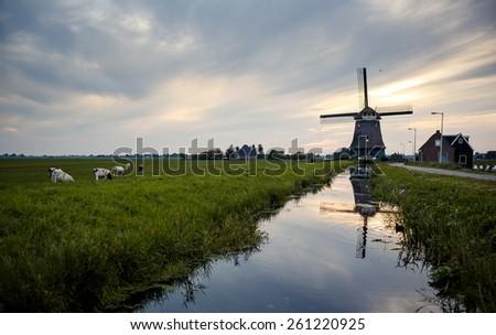 Traditional Dutch windmill, near Volendam, Holland - stock photo