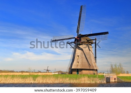 Traditional Dutch windmill o the side of a canal in Kinderdijk, Holland