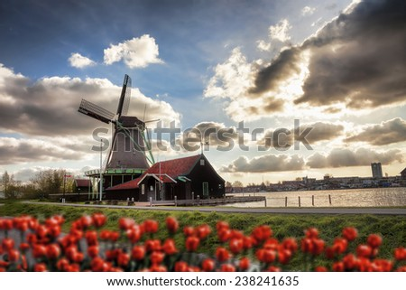 Traditional Dutch windmills  in  Zaanse Schans, Amsterdam area, Holland - stock photo
