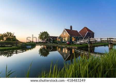 Traditional Dutch windmills with canal close - stock photo