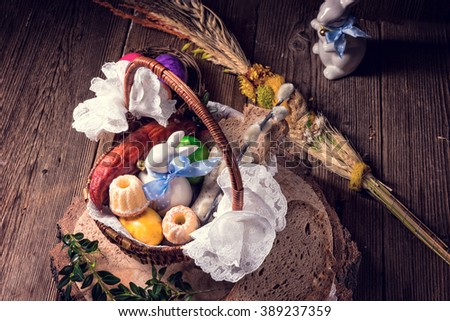 Traditional Easter basket with food - stock photo