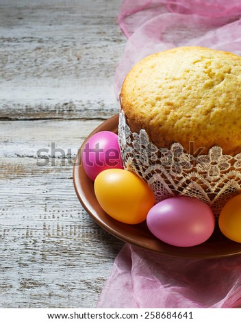 Traditional Easter cake and painted eggs. Selective focus