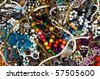Traditional eastern bright colorful costume jewelery on a street market table. Good for background. - stock photo
