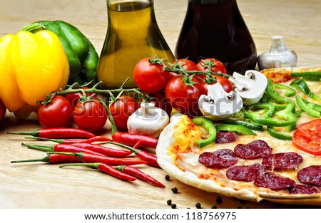 Traditional eastern thin pizza plate arranged with different props. - stock photo