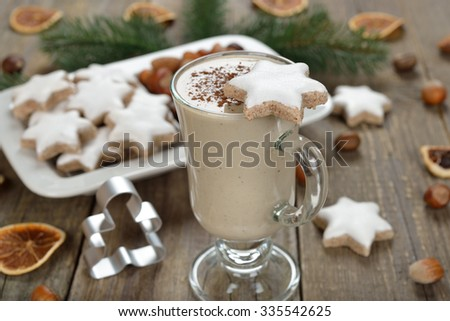 Traditional eggnog on wooden background - stock photo