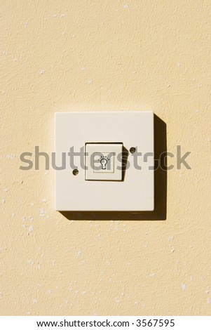 traditional electrical switch on the wall - stock photo