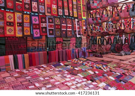 traditional embroidered handmade souvenirs on the Sunday market in Sa pa