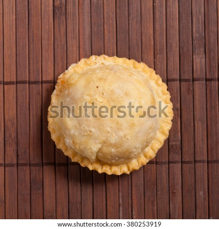 Traditional empanadas on wooden surface - stock photo