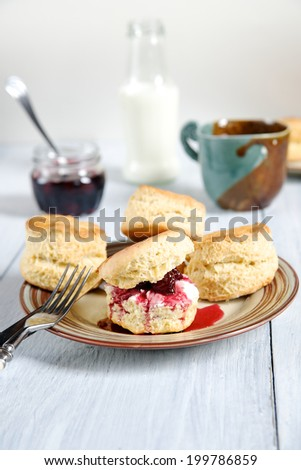 Traditional English baking - scones with tea, milk and jam - stock photo