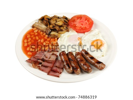 Traditional English breakfast - tomatoes, fried sausages, bacon, mushrooms, eggs and tomato baked beans - stock photo