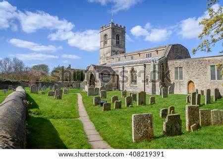 Traditional English church with graveyard on a sunny day