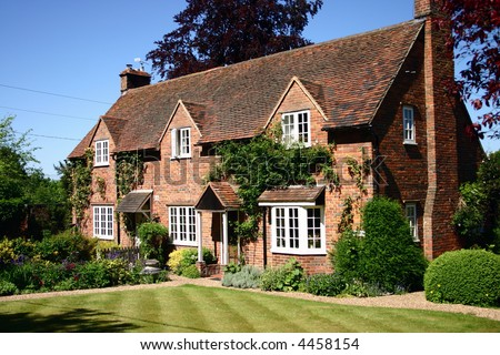 Traditional English Country Cottage - stock photo