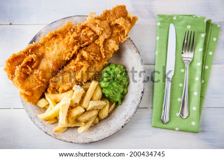 Traditional English food - Fish and chips with mushy peas - stock photo