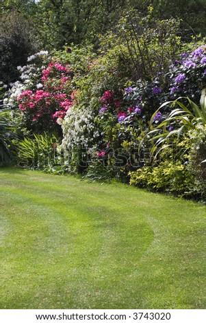 Traditional English garden (vertical) - stock photo