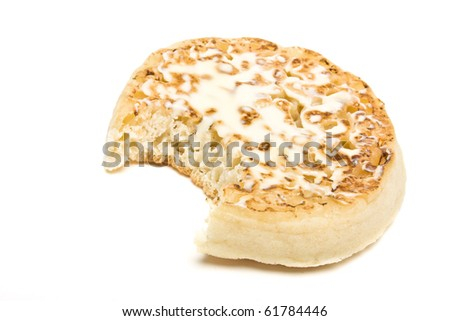 Traditional English Hot Buttered Crumpet with melting butter.