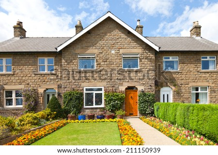Traditional english house and garden - stock photo