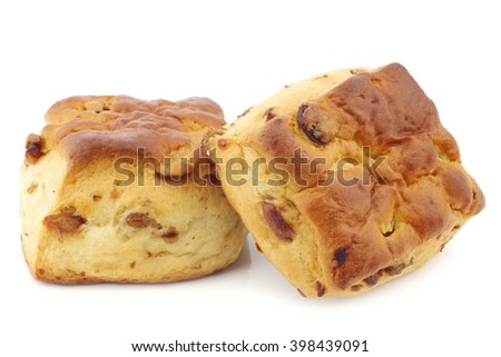 traditional english scones with raisins on a white background - stock photo