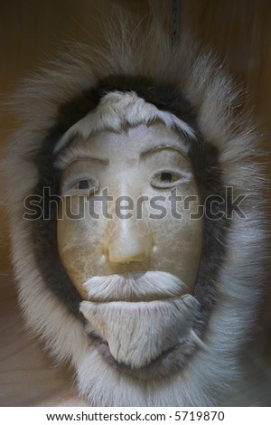 Traditional eskimo mask made of skin and fur - stock photo