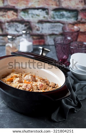 Traditional Estonian stew with cabbage and barley (Mulgikapsad) in cast iron pan, selective focus - stock photo