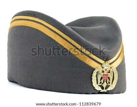 Traditional ethnic hat with Serbian emblem - stock photo