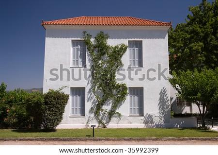 traditional european house with garden in greece - stock photo