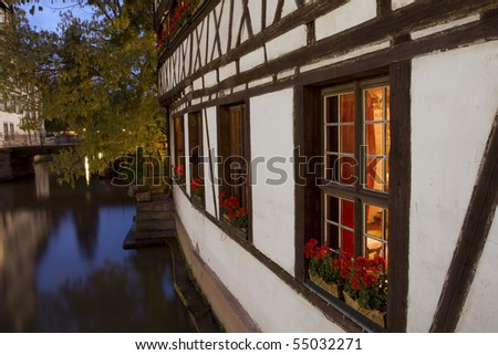 Traditional exterior of Alsace house in summer time - stock photo