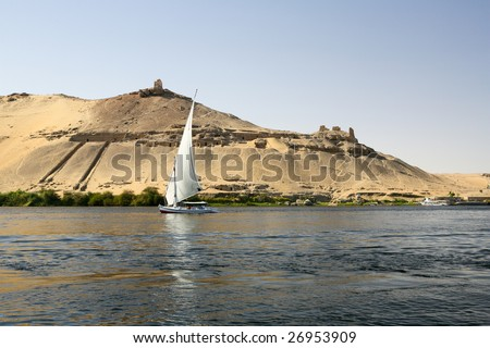 Traditional Faluka or Nile Fishing Boat Sailing Past Temple