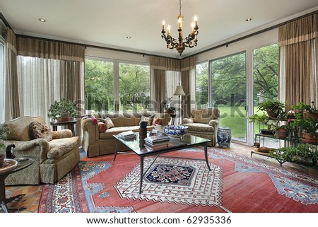 Traditional family room with doors to patio - stock photo