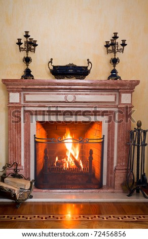 traditional fireplace, natural wood burning brightly - stock photo