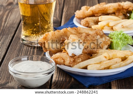 Traditional fish and chips with tartar sauce on a plate - stock photo