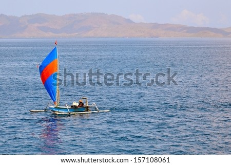 Traditional fisher-boat sailing near the Lombok coast, Indonesia