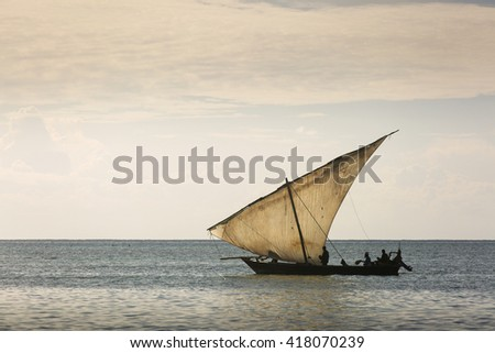 Traditional Fisherman Dhow Boat during the day, Zanzibar, Tanzania - stock photo