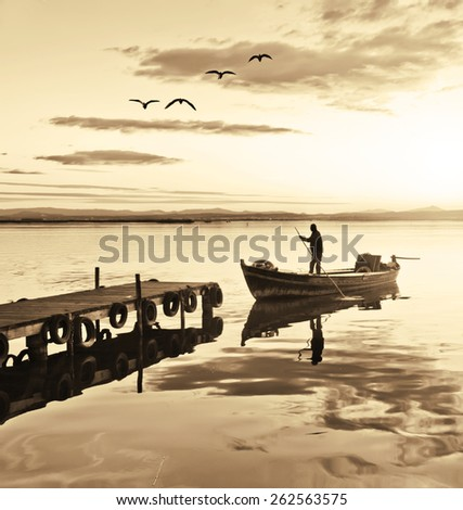 traditional fisherman in his boat - stock photo