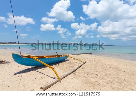 Traditional fishing boat on Jimberan beach in Bali, Indonesia. - stock photo