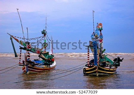 Traditional fishing boats docked at the small fishing village of Pasir Putih, Java, Indonesia.