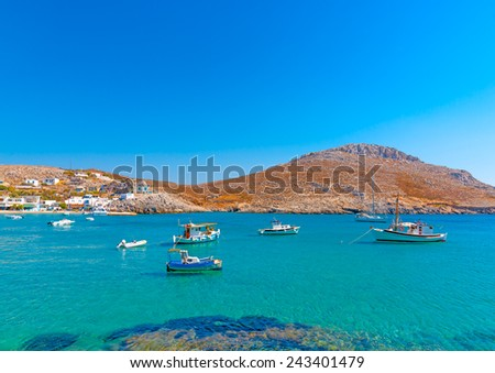 traditional fishing boats docked in the port of Pserimos island in Greece - stock photo