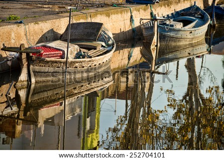 Traditional fishing boats in a small canal, Albufera, Valencia, Spain
